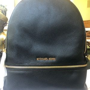 Brand New Michale Kors Black leather backpack